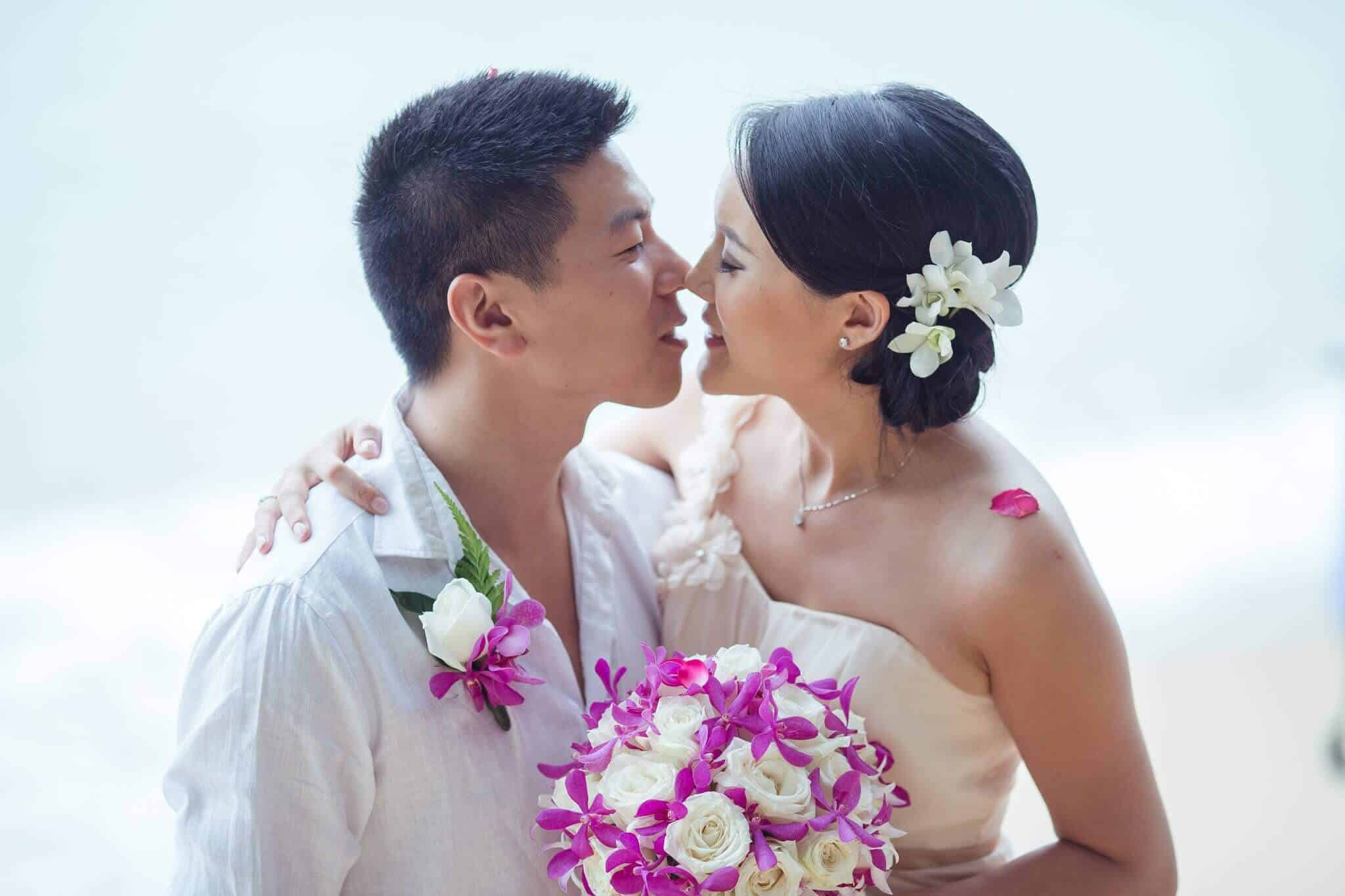 Phuket Beach Wedding - Kiss Bride and Groom